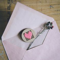 Cross stitch heart pin, easy to make for Valentine's Day.