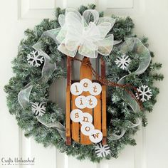 """Add a touch of winter to your door with this gorgeous """"Let It Snow"""" DIY winter wreath. It's simple to make & is perfect for the entire winter season!"""