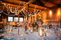 I've fallen completely in love with Gallery 1028 and this pretty, little gem sent into us by Ashley Biess Photography. The twinkling lights, suspended frames and that sweetheart table are all just so fabulous, I can't decided which detail I love the most.