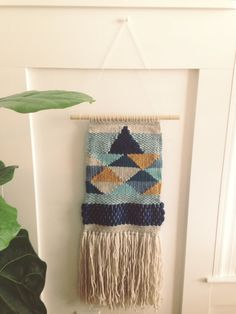 Woven wall hanging handmade on a lap loom. This weaving is made using warp string, wool yarns, and hand painted silk. Hung on a 12 wooden dowel, the