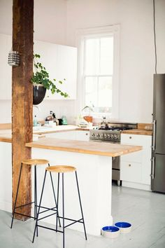 white kitchen with butcher block counter