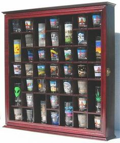 41 Shot Glass Display Case Cabinet Holder Rack, Cherry Finish (SC03-CH) by NULL. $74.95. Gallery quality at Factory Direct Price. Display case crafted from solid wood. Hinged glass door to prevent dust and protect. No Assmebly required. Wall mountable with brackets already on the back. A great way to display your Shot Glass collections. Hand crafted from hand selected solid wood. Black matted background to create a lovely display. Brass hinges, door latches, and...