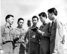 Japanese-American soldiers of US 442nd Regimental Combat Team singing 'Abide in Me' at the memorial ceremony for fallen soldiers, Cecina Area, Italy, 30 July 1944. (Hawaii War Records Depository)