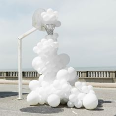 White Balloons Invade Various Places In Surreal Installations By Charles Pétillon