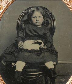 Tintype of little girl with pet rabbit