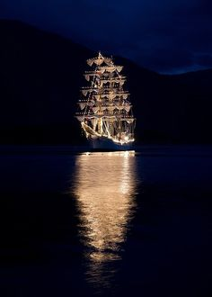 A Tall Ship Lit Up At Night