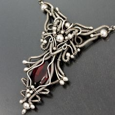 Necklace   Sarah Thompson.  Fine silver wire, sterling silver beads and a Madeira citrine.