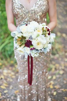 #gold wedding dress and crimson ribbon | Photography: Untamed Heart Photography - untamedheartphotography.com  Read More: http://www.stylemepretty.com/2014/03/21/industrial-glam-gold-glitter-wedding/
