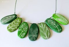 polymer clay necklace - this would look really nice on a twine sort of string.