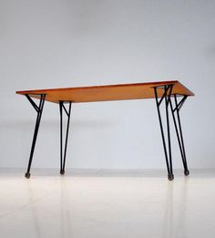 Alfred Hendrickx; Enameled Metal and Wood Dining Table for Belform, c1958.