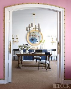 Carolina Herrera Baez's Dining Room: The table and mirror in the dining room are by López-Quesada.