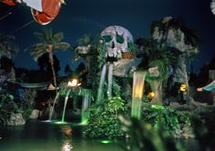 Skull Rock at night. This was the backdrop for the Captain Hook's Pirate Ship restaurant; Disneyland, 1963
