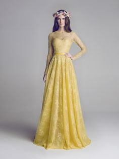 gorgeous evening dress / evening gown by UAE based designer Hamda Al Fahim | yellow chartreuse lace gown with long-sleeves | sweetheart neckline with lace overlay | v-neck in the back / v-back | flower crown | beautiful modest evening dress