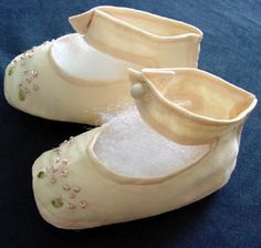 1930's pale pink silk baby shoes with hand embroidery and pearl buttons