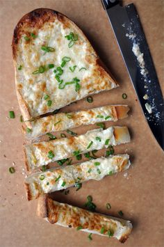 Cheesy Garlic bread ... mix up cheese, butter, mayo,  scallions and garlic and spread on french bread and bake - YUM