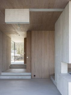 Modern house in Riehen made by glass, concrete, wood, and metal serve, designed by Reuter Raeber Architects - CAANdesign Concrete Interiors, Wood Interiors, Concrete Wood, Concrete Floors, Architecture Résidentielle, Minimal Home, House And Home Magazine, Minimalist Design, House Design