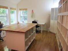 IKEA expedit plus wooden counter top for work station http://nestedinstitches.com/2012/05/21/my-sewing-studio/