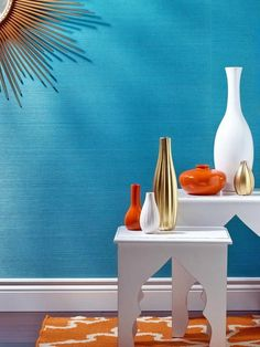 The color combination of turquoise, tangerine, gold and white presents an exotic, global feel, especially when introduced through vases and curved end tables. Each color, although used differently, appears balanced and equal. Photo courtesy of Phillip Jeffries