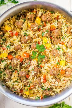Easy One-Skillet Sausage and Peppers with Rice - Juicy sausage, crisp peppers, onions, and rice all cook together in one skillet! Makes cleanup a breeze! Packed with flavor and ready in 30 minutes! Sausage Rice, Sausage And Peppers, Spicy Sausage, Stuffed Peppers, Sausage Crockpot Recipes, Italian Sausage Recipes, Sweet Italian Sausage, Rice Recipes, Pork Recipes