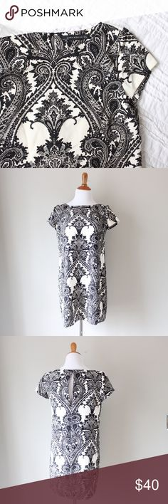 """Geometric Printed Short Sleeve Shift Dress Gorgeous black and white printed short sleeve sheath dress with buttonhole closure in back. Slip on style. In excellent gently used condition.   Bust: 18"""" Waist: 19"""" Hips: 21"""" Length: 32"""" Size: Medium  All orders ship next business day! Zara Dresses"""