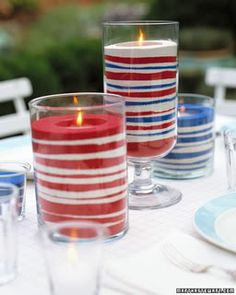 These simple and easy to make candles would look great (and not to screamingly patriotic) when paired with lots of white table linens and placesettings. Red, White, and Blue Buffet Silverware Holders (from Martha Stewart):