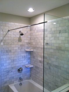 This Tub Shower Benefits From A Glass Splash Panel As Well The Rod For