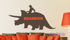 Check out this item in my Etsy shop https://www.etsy.com/listing/216490489/dinosaur-cowboy-rider-custom-vinyl-name