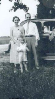 My paternal grandparents Vera Belle and Glen Buller.  The child is a friend, Neil Armstrong, future astronaut and first man to set foot on the moon. The photo was taken near Wapakoneta, Ohio and is from the collection of Neil Armstrong.  I was shocked to find it online.  It is the first time I ever saw my grandparents at all--they both died before I was born.  Grandma looks just like one of my cousins.
