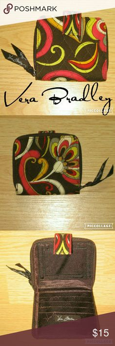 Vera Bradley Fall Colors Wallet This wallet is in excellent preowned condition. Looks to have been hardly in use. Beautiful Fall colors of brown, red, yellow, orange, and white. Vera Bradley Bags Wallets
