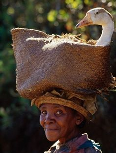 Woman taking goose to market, Central Madagascar, Africa - by Frans Lanting (1951), Dutch