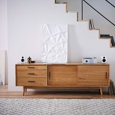 Step up your living room game with our Mid-Century console.
