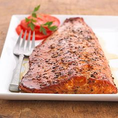 Maple smoked salmon These salmon fillets are treated to a double dose of maple syrup. The recipe serves as a marinade and is also brushed on while cooking in the smoker. Grilling Recipes, Fish Recipes, Seafood Recipes, Paleo Recipes, Great Recipes, Favorite Recipes, Honey Recipes, Fish Dishes, Seafood Dishes
