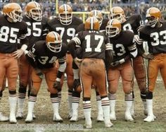 The Kardiac Kids' offense in the huddle during a game at Cleveland Stadium: (l-r) Dave Logan, Doug Dieken (behind Logan), Calvin Hill, Henry Sheppard, Brian Sipe, Tom DeLeone, Mike Pruitt and Robert E. Jackson.