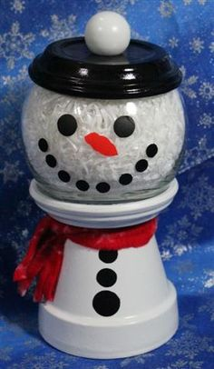Snowman candy jar made from clay pot and saucers. :)