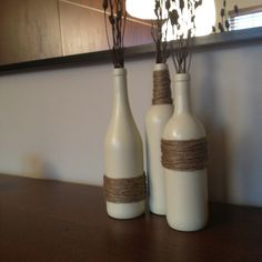 Spray paint old wine bottles and wrap with twine, super easy and so cute!