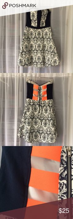 Printed strapless dress Stunning A-line strapless dress with a navy blue printed pattern and bright orange strapping detailing on the back. Cotton and spandex material give the dress a slightly stretchy fit that is comfortable to wear. blue rair Dresses