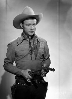 Roy Rogers posed in Cowboy Outfit with Two Guns Premium Art Print