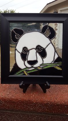 Stained glass panda measures 8 x 8