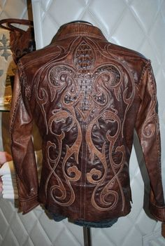Custom bikers jacket by Logan Riese This jacket with all hand cut logos and leather is part of the Billionaire Bikers line.