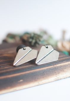 "This pair of plane shaped earrings has an unique design, a perfect edition to a pretty outfit.  Stud Size: 1 3/4"" Weight: 10g Post Back Onyx matte / silver"