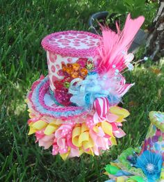 Mad hatter hat for Alice party Mad Hatter Party, Mad Hatter Tea, Mad Hatters, Easter Hat Parade, Teacup Flowers, Painting The Roses Red, Alice In Wonderland Tea Party, Crazy Hats, Pink Parties