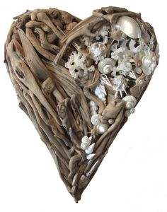 This commission piece uses exquisite shells to add that very special touch to this driftwood heart.   Size 70cm x 50cm.   They can be made to a size of your choice so please contact me for more details.   £555.00