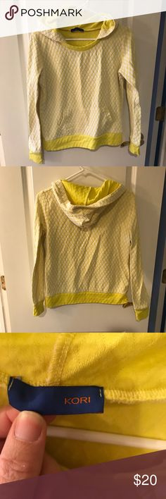 Yellow hoodie Cute yellow hoodie that has a quilted look. I am not sure the size but i am in between a medium and large and this fits more like a medium. Kori Tops Sweatshirts & Hoodies