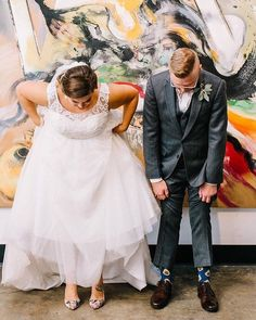We love a pop of color, from his socks to your shoes! Find the dress perfect for your playful bridal look; book your appointment at the link in our profile! #DavidsBridal Photo by @sarabeephoto via @100layercake . . Style WG3741 | Under $700