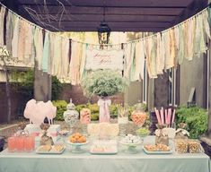 This is really pretty vintage / rustic wedding sweet buffet, love the hanging 'rag' streamers in the background and pastel colour palette. The decor goes so beautifully with the desserts, cotton candy / candy floss and lollipops. The garland would be really easy to make yourself, just strips of fabric knotted onto a line...