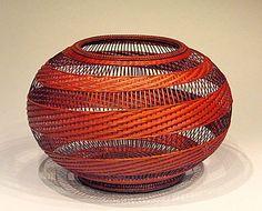 """KAJIWARA Aya """"Spiral Pattern Flower Basket"""", Kajiwara is one of the first female bamboo artists to become a full member of the Japan Craft Arts Association. An award winning artist Bamboo Basket, Rope Basket, Flower Basket, Basket Weaving, Wicker Baskets, Bamboo Art, Bamboo Crafts, Paper Weaving, Weaving Art"""