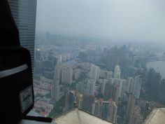 Panoramic view of Shanghai with my ever trusted companion, my backpack :-) at the Shanghai Jin Mao Tower: the Third Tallest Building in Mainland China
