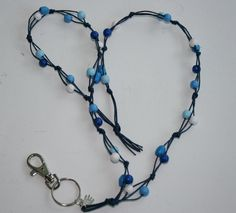 Avainnauha by Miss Piggy / Key chain, ID holder, made with wooden beads and waxed cord Beaded Lanyards, Id Holder, Key Chains, Wooden Beads, Diy And Crafts, Cord, Helmet, Beaded Necklace, Bracelets