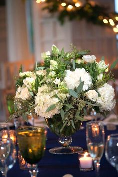 Malloy Events at Bald Peak Colony Club in Moultonborough, NH. centerpieces of white hydrangea, seeded eucalyptus, green parrot tulips, anemones, and star of Bethlehem
