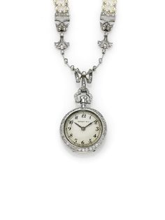 RETAILED BY TIFFANY & CO. - A FINE PLATINUM DIAMOND-SET AND PEARL PENDANT WATCH MVT 160672 CIRCA 1910